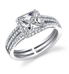 .http://ocbridemag.com/index.php  Love to see pictures of our brides rings. This is truly an elegant ring.