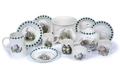 49. A POOLE POTTERY 'MAD HATTER'S TEA PARTY' PART TEA SET - Mallams DESCRIPTION  printed with inscriptions and scenes after Tenniel, comprising teapot and cover, milk jug, baby dish, three mugs, a cup, two saucers and two plates, together with a similar Poole pottery jardiniere