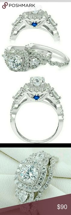 NWT Round Cz 925 Wedding Set Size 6 A beautiful set that has a lot of compliments. Compare to the Vera Wang Collection. 2 small Blue cz's along both sides of the ring and many white cz's. Stamped 925. Jewelry Rings