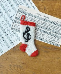 Treble Clef Hand-Knit Christmas Stocking Ornament - brand new and so perfect for a piano teacher, songbird or budding musician!  https://www.etsy.com/shop/HandmadeMaryEllen