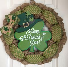 """Burlap St. Patrick's Day Wreath - St. Patty's Day Wreath - St. Patrick's Day Door Hanger - Burlap Shamrock Wreath - Four Leaf Clover Wreath. Burlap St. Patrick's Day wreath made on a 16"""" wire frame. The finished product is about 20"""" in diameter. Each wreath is handmade and may differ slightly from the example shown in the photo. I make every effort to ensure each wreath is full and even. All my wreaths are made to order so please allow 1-2 weeks of processing time. Thank you for your..."""