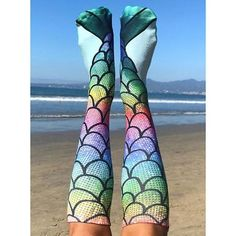 Show off your mermaid tail with these knee high 100% polyester mermaid socks by Living Royal. Made in the USA. Bright rainbow colors. Forms a mermaid tail when shown together.<br><br>Size - One size f