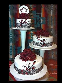 """Offset Navajo Branch Cake - This was 6""""-8""""-10"""" rounds covered in MMF. I used wire to make the branches I covered them in floral tape and airbrushed them brown. The flowers are artificial cherry blossoms and the black lace ribbon is real.  The Navajo Wedding Basket topper is made out of fondant then hand painted. TYFL   Mark Mexicano"""