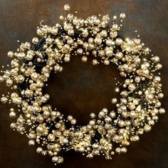 Bring life to your holiday decor with our illuminated berry glitz gold wreath. This 24 inch wreath features bendable twigs accented with glitzy gold ornaments and illuminated by warm white LED lights,...