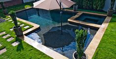 Imagine a beautiful in-ground pool situated right in your own backyard. A built-in umbrella stand creates the perfect spot to entertain.