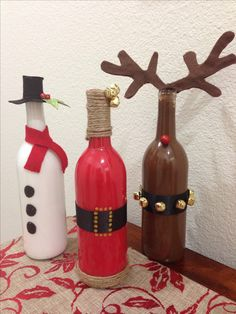 These are such a great way to reuse old wine bottles! Too cute! christmas wine bottle craft, wine bottle crafts, christma wine, christmas crafts, christma decor, wine bottles, christma craft, diy christmas decorations, snowman painted on wine bottle