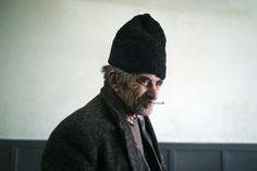 Gypsy man smoking in a bar in Transylvania.