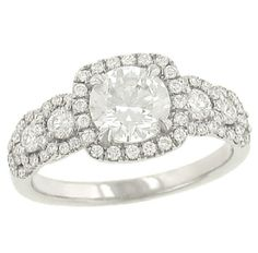 Just giving the hubby some ideas for my 10-year anniversary wedding set upgrade.....    Step and Halo Design Pave and Round prong Set Diamond Engagement Ring Diamond .61cttw.  Solomon Brothers.