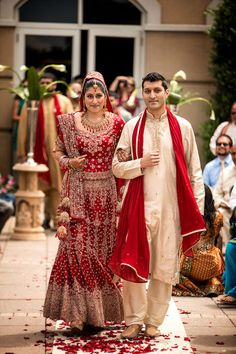 Bride walking down the aisle at an Indian wedding in North Carolina- http://www.charlotteobserver.com/2012/10/29/3630641/the-perfect-arrangement.html#