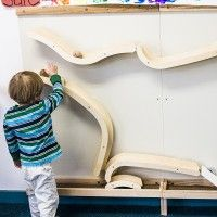 The curvy, magnetic wooden ramps inspire children to build magnetic ball pathways that expand their thinking about motion, force, and gravity. Beacon School, Diy Toys Car, Wooden Ramp, Kids Magnets, Play Yard, Magnetic Wall, Wooden Coasters, Library Design, Kids Corner