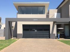 Beautiful charcoal aluminium and glass Coro-View® garage door. Glass And Aluminium, Aluminium Doors, Aluminum Garage, My House, Charcoal, Garage Doors, Mansions, House Styles, Outdoor Decor