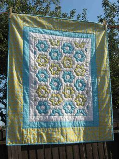 Hexagon quilt. I like the finishing borders on this one KM