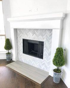 Love the marble herringbone tile design of this fireplace! Love the marble herringbone tile design of this fireplace! Fireplace Tile Surround, Fireplace Redo, Farmhouse Fireplace, Fireplace Remodel, Brick Fireplace, Fireplace Surrounds, Fireplace Ideas, Fireplace Backsplash, Tiles For Fireplace