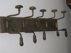 Old hand drills and barnwood make a great coat rack.  The drills are not the same size or the same colors.