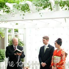 The ceremony took place in a garden behind the cottage. To make the space feel more secluded, a tulle backdrop and strings of origami cranes and hung from the pergola. An Intercultural Wedding in Story City, IA