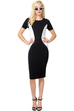 A cool it girl midi dress featuring contrast panels and a round neck. Short sleeves. Defined waist. Back vent. Finished hem. Textured knit. Unlined. Bodycon fit.