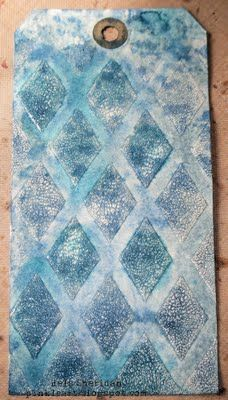Use Rock Candy Cracklepaint over stencil, let dry, sponge on Distressed ink, wiping off the ink from the Cracklepaint.