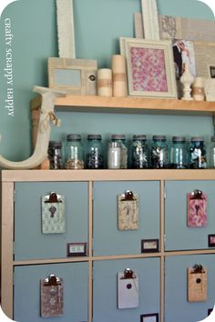 craft room ideas - add doors to cube shelving to hide the mess. decorated clipboards for info on the insides