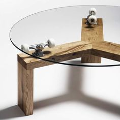 A very cool furniture design by Studio Maurer Hendrichs. It's called Three Sixty Table and uses upcycled skateboard trucks to support a glass plate.