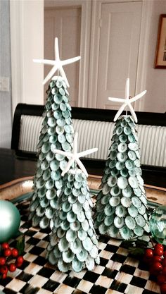 These unique Natural Aqua Shells and Starfish Christmas Trees are handmade from natural aqua green limpet shells and starfish. They make an amazing centerpiece surrounded by ornaments and berries. …