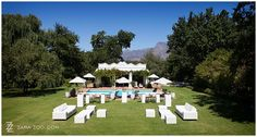 Pre-drinks area with white furniture on lawn at Vrede en Lust, Franschhoek, South Africa - ZaraZoo Photography