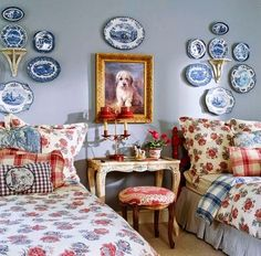 Blue plates purchased on a trip to Europe decorate the walls in this Charles Faudree-designed bedroom. - Traditional Home ® / Design: Charles Faudree
