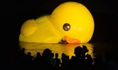 An 18-metre tall inflatable duck is pictured during its unveiling at the historic Summer Palace in Beijing on September 25, 2013. The duck designed by Dutch artist Florentijn Hofman is to be displayed at Beijing's Garden Expo Park and the Summer Palace, from September to October as part of a world tour of 13 cities across 10 countries. AFP PHOTO / Mark RALSTON MARK RALSTON / AFP