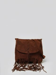 Dark brown leather shoulder bag featuring a flap closure, woven detailing, fringe trim and raw edges