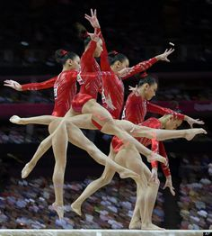In this multiple exposure photo, U.S. gymnast Kyla Ross performs on the balance beam during the Artistic Gymnastics women's team final at the 2012 Summer Olympics, Tuesday, July 31, 2012, in London.