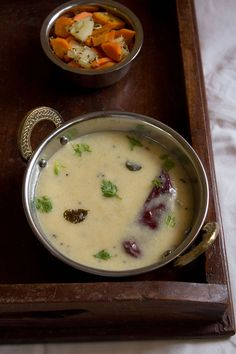 gujararti kadhi recipe with step by step photos. this is a quick gujarati kadhi recipe. kadhis are excellent for summers as they are cooling. the gujarati kadhi is a light dish. Dahi Kadhi Recipe, Gujarati Kadhi Recipe, Sambhar Recipe, Gujarati Recipes, Indian Food Recipes, Rajasthani Recipes, Dhal Recipe, Garlic Recipes, Veggie Recipes