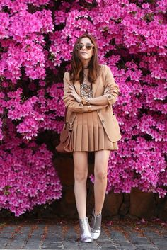 Spring outfit wearing camel pleated skirt, sequined top and camel blazer. Breaking the monochromatic look with glitter boots.