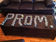 I asked this guy I like to prom! I used empty dip cans and bullets for the question mark! And the dot to the question mark was a full one! He had no idea and absolutely loved it! It was pretty redneck! But it was my idea, thought maybe someone else could use it!:)
