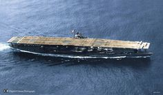 """Digitally colourised version of the photo of the carrier Akagi, after her reconstruction. Clearly visible in the photo , the huge downward curving funnel exhaust on the starboard side, the """"humped"""" shape of the flight deck, and the small port-side island. The Japanes Navy was the only one to have carriers with islands on the port side as well as the starboard side. The carriers Kaga and Akagi were intended to operate as a """"pair"""" so Kaga had a starboard side island, Akagi a port side one, so…"""