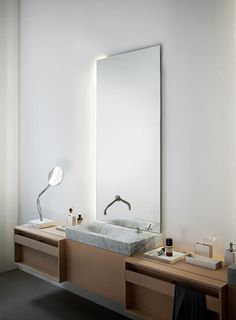 Agape, Nudo mirrors #agapedesign can be fitted with LED lighting on one or more sides, thus enriching the bathroom with a particular light + Plus front panel http://www.agapedesign.it/en/products/567-plus. Learn more on agapedesign.it
