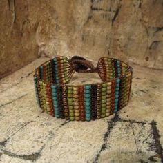 Versicolor Bracelet made on the Knotty-Do-It-All Board with seed beads.