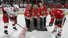 Niclas Wallin (@Carolina Hurricanes Hockey) and Brent Seabrook (@Chicago Blackhawks) pose for the ceremonial puck drop with legends Dennis Hull, Jim Pappin, and the late Pit Martin's long time partner Denise on March 11, 2009.