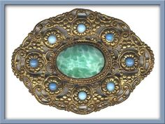 Vintage Bohemian brass and glass stone brooch