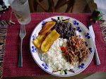 Pabellón criollo, traditional dish with rice, fried plantain, black beans and shredded beef.