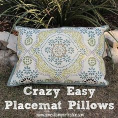 Placemats + fabric waterproofing spray = cheap and easy outdoor throw pillows. | 51 Budget Backyard DIYs That Are Borderline Genius