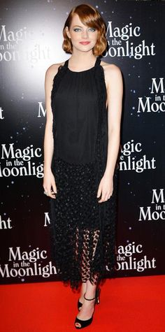 Emma Stone wowed at the Magic in the Moonlight in a fringed black Chloe design with a lace skirt. Retro waves, Melinda Maria earrings, and black velvet ankle-strap Christian Louboutin sandals with flower embellishment.