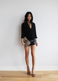 going out: draped blouse, leather shorts, minimalist strappy sandals