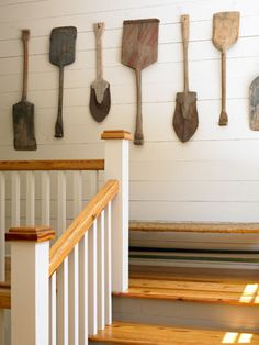 Large utilitarian objects like these Swedish snow shovels can offer a striking way to fill a blank wall.