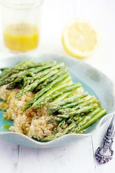 A fresh quinoa and asparagus dish that's perfect for springtime! This healthy dish is finished with a lemon mustard vinaigrette. #vegan