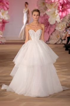 """Bridal fashion for 2017 - Key trends from Bridal Fashion Week - Peek a boo sides - """"Happy"""" strapless sweetheart ball gown with natural waist and exposed corset by Ines Di Santo."""