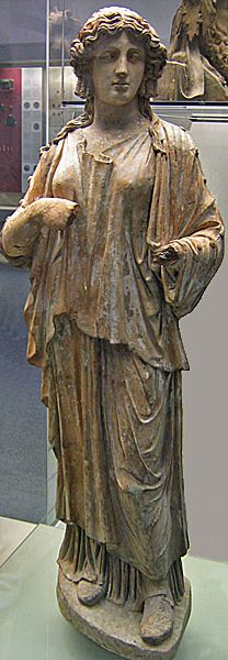 Muse, Lifesize painted terracotta statue, 50-100 CE Young woman wearing Greek clothing. One of 8 statues from Porta Latina, Rome
