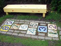 hopscotch garden mosaic... my girls would love this!  Maybe we can stop Making hopscotch on the carpet with masking tape.  Lol