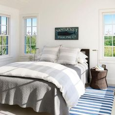 In this Nantucket cottage bedroom, new windows ensure the small space receives plenty of natural light.   Coastalliving.com