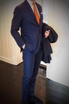 Pinstriped suit and wool coat.