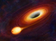 As a star approaches a supermassive black hole, it is ripped apart by gravitational forces (artist's impression).
