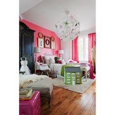 Butterfly chandelier, furry materials, and hot pink accents creating a classy girly atmosphere into this girl bedroom. #rumahkubedroom